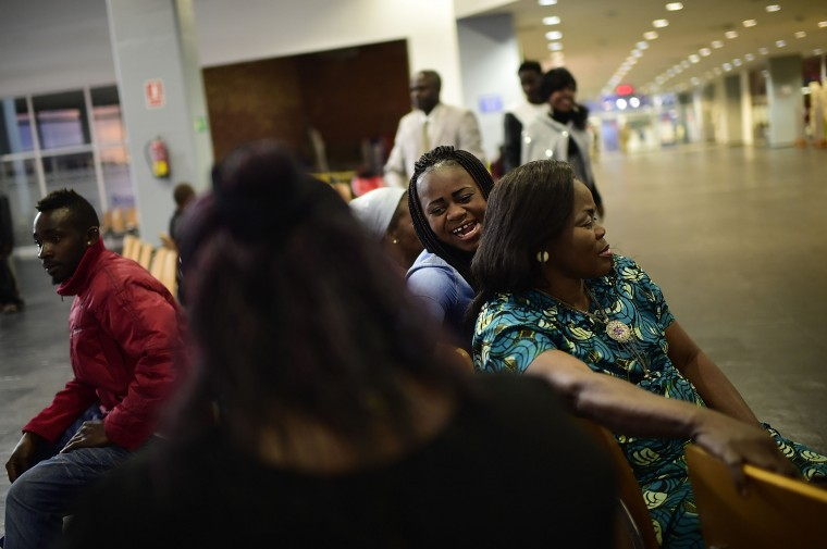 African refugees wait inside the ferry terminal on the north African Spanish enclave of Melilla, where they will later board a cruise ship heading to Malaga on the Spanish mainland, on April 2, 2014, in Melilla, Spain. Melilla is a Spanish city and an exclave on the north coast of Africa sharing a border with Morocco. Almost one week ago some 800 sub-Saharan people made several attempts to reach Spain and according to official sources, ten of them managed to enter Spanish territory. The migrants hide just west of the city centre and try to cross the 7-meter high fence to Melilla and into the European Union in hope of a better life.  (Photo by Alexander Koerner/Getty Images)