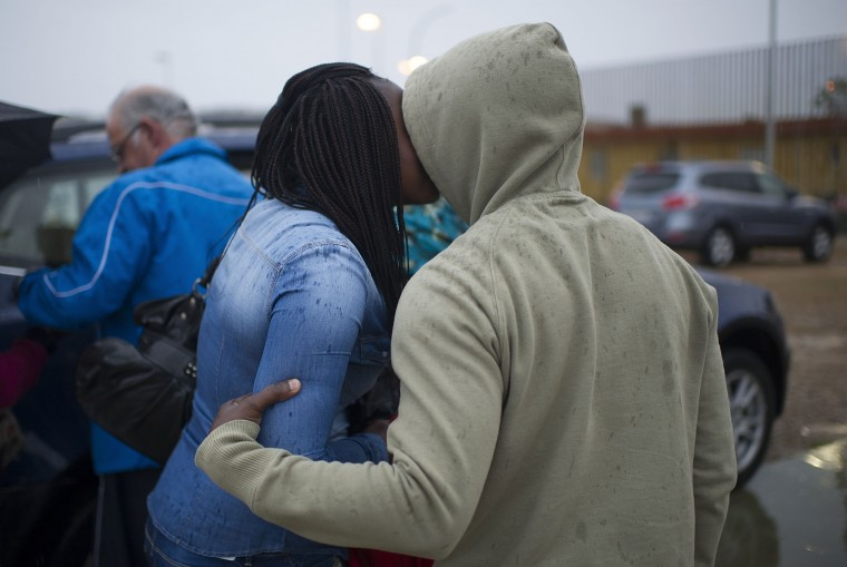 An African refugee kisses a woman as he leaves the Centre for Temporary Stay of Immigrants (CETI) on the north African Spanish enclave of Melilla, before making his way to the Ferry Terminal of Melilla where he is planning to board a cruise ship later in the night heading to Malaga on the Spanish mainland, on April 2, 2014, in Melilla, Spain. Melilla is a Spanish city and an exclave on the north coast of Africa sharing a border with Morocco. Almost one week ago some 800 sub-Saharan people made several attempts to reach Spain and according to official sources, ten of them managed to enter Spanish territory. The migrants hide just west of the city centre and try to cross the 7-meter high fence to Melilla and into the European Union in hope of a better life.  (Photo by Alexander Koerner/Getty Images)