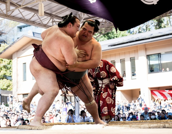 Professional sumo wrestler Kotoshogiku Kazuhiro (R) pushes his opponent Kisenosato Yutaka during the Ceremonial Sumo Tournament or Honozumo at the Yasukuni Shrine on April 4, 2014 in Tokyo, Japan. (Photo by Keith Tsuji/Getty Images) ORG XMIT: 481102161