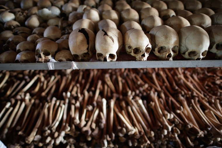 Showing signs of extreme trauma, victims' skeletal remains are displayed on metal racks inside the Ntarama Catholic Church genocide memorial ahead of the 20th anniversary of the country's genocide April 4, 2014 in Nyamata, Rwanda. Attackers used grenades to blast their way inside the church on April 14 and 15, 1994 where 5,000 people had taken refuge, killing men, women and children. The church was turned into a memorial site and contains the remains, the majority of them Tutsi, of those who were massacred inside the church itself. (Chip Somodevilla/Getty Images)