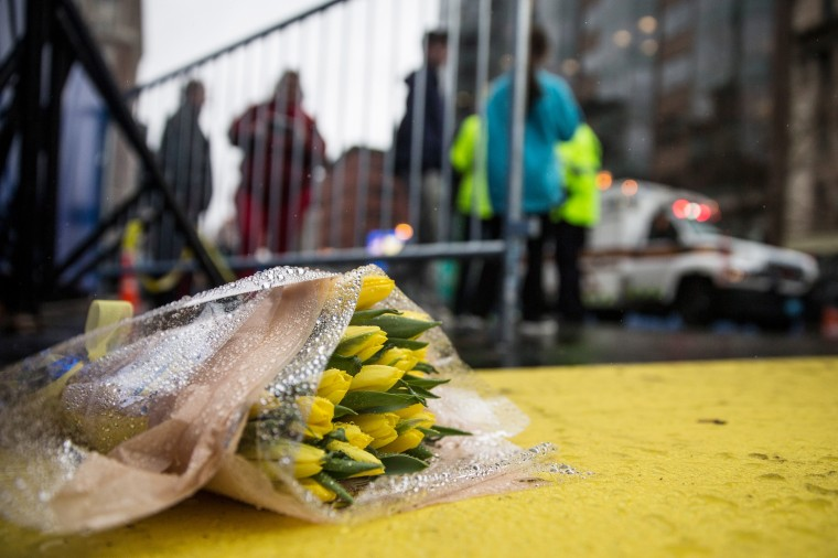 Flowers lie on the finish line of the Boston Marathon on the one year anniversary of the 2013 Boston Marathon Bombing, on April 15, 2014 in Boston, Massachusetts. Last year, two pressure cooker bombs killed three and injured an estimated 264 others during the Boston marathon, on April 15, 2013. (Photo by Andrew Burton/Getty Images)