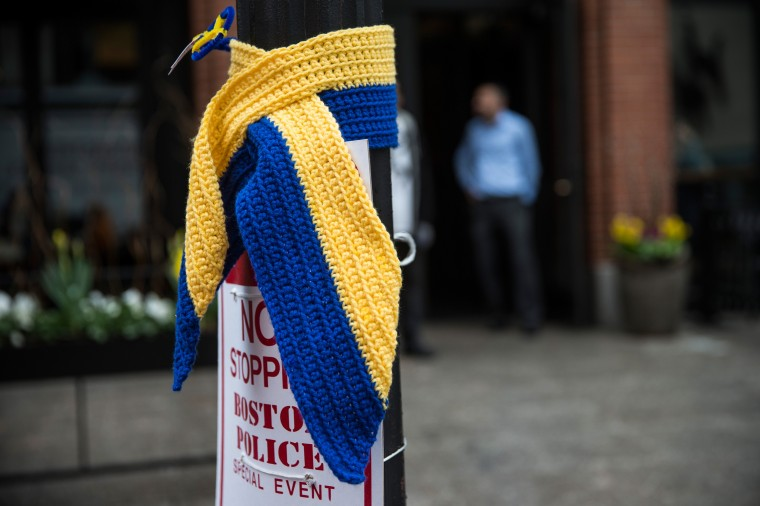 A knitted tribute hangs on a street light along the course of the Boston Marathon on the one year anniversary of the 2013 Boston Marathon Bombing, on April 15, 2014 in Boston, Massachusetts. Last year, two pressure cooker bombs killed three and injured an estimated 264 others during the Boston marathon, on April 15, 2013. (Photo by Andrew Burton/Getty Images)