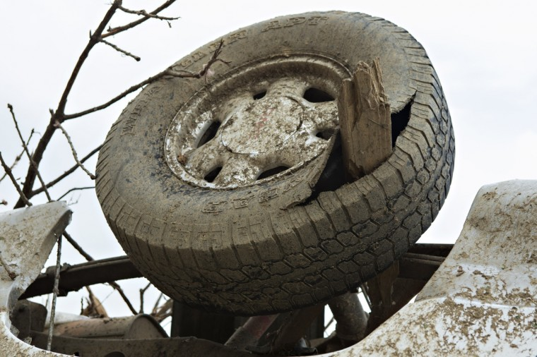 Tire punctured by a board sits upside down after a strong tornado went through the area on April 27 for the second time in three years on April 28, 2014 in Vilonia, Arkansas. After deadly tornadoes ripped through the area and have left over a dozen dead, Mississippi, Arkansas, Texas, Louisiana, and Tennessee are all under watch as multiple storms over the next few days are expected. (Wesley Hitt/Getty Images)