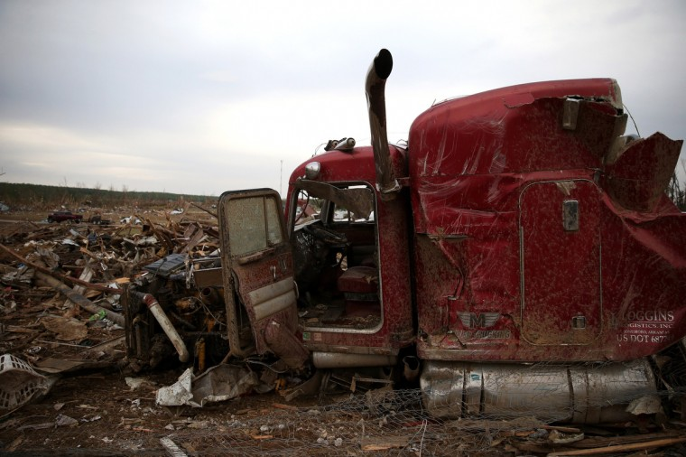 The remains of a large truck destroyed by a tornado on Sunday evening rests amid the debris, on April 29, 2014 in Vilonia, Arkansas. After deadly tornadoes ripped through the region leaving more than a dozen dead, Mississippi, Arkansas, Texas, Louisiana and Tennessee are all under watch as multiple storms over the next few days are expected. (Mark Wilson/Getty Images)