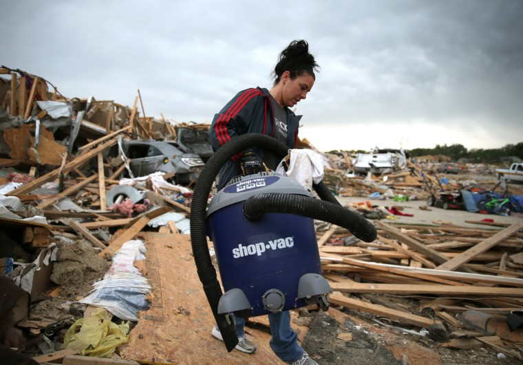 Michelle McGee removes belongings from her home that was destroyed by a tornado on Sunday, April 29, 2014 in Vilonia, Arkansas. After deadly tornadoes ripped through the region leaving more than a dozen dead, Mississippi, Arkansas, Texas, Louisiana and Tennessee are all under watch as multiple storms over the next few days are expected. (Mark Wilson/Getty Images)