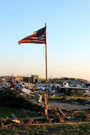 An American flag stands amongst the rubble of a community following a deadly tornado April 28, 2014 in Vilonia, Arkansas. Arkansas National Guard members continue to respond to emergency declared disaster areas within the state of Arkansas. At least 11 people were killed Monday after a tornadoes touched down in Alabama, Mississippi and Tennessee, bringing the overall death toll from two days of severe weather to at least 28. (Arkansas National Guard via Getty Images)