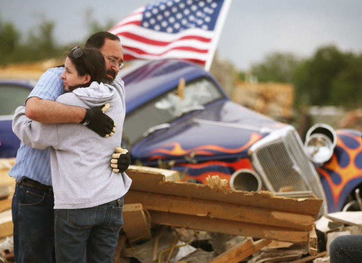 Dan Wassman gets a hug from a friend Amy Lundsford at the homesite of his son, also named Dan Wassum, who was killed when a tornado destroyed his home late Sunday afternoon, April 29, 2014 in Vilonia, Arkansas. Deadly tornadoes ripped through the region April 27, leaving more than a dozen dead. (Mark Wilson/Getty Images)