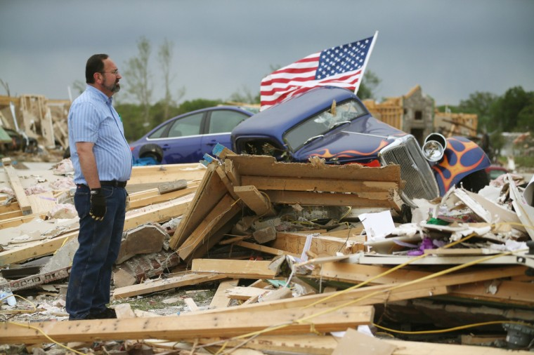 Dan Wassman looks at the debris at the homesite of his son, also named Dan Wassum, who was killed when a tornado destroyed his home April 29, 2014 in Vilonia, Arkansas. Deadly tornadoes ripped through the region April 27, leaving more than a dozen dead. (Mark Wilson/Getty Images)
