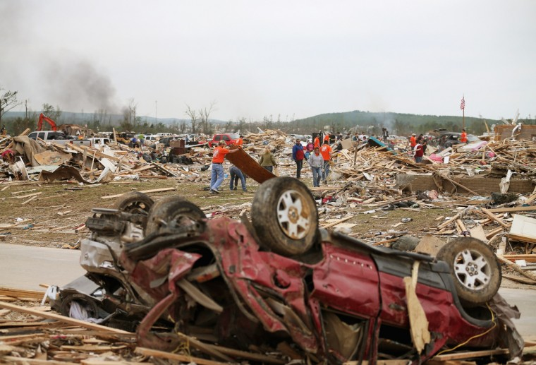 Volunteers help clean up debris where homes once stood after the area was hit by a tornado April 29, 2014 in Vilonia, Arkansas. Deadly tornadoes ripped through the region April 27, leaving more than a dozen dead. (Mark Wilson/Getty Images)