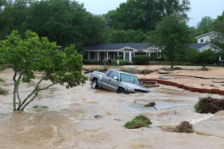 A truck is stuck in the middle of flooded Piedmont Street in the Cordova Park neighborhood after it washed out due to heavy rains on April 30, 2014 in Pensacola, Florida. A major storm system that brought tornadoes to regions of the South dumped more than two feet of water in a little over a day in the Florida Panhandle. (Marianna Massey/Getty Images)