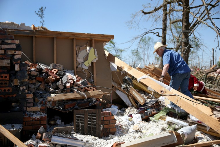 Joe Kelley looks through what is left of his brother's home after the home was destroyed on Monday by a tornado on April 30, 2014 in Louisville, Mississippi. Deadly tornadoes ripped through the region starting on April 27 leaving more than two dozen dead. The storm system has also brought severe flooding to Florida's Panhandle. (Joe Raedle/Getty Images)