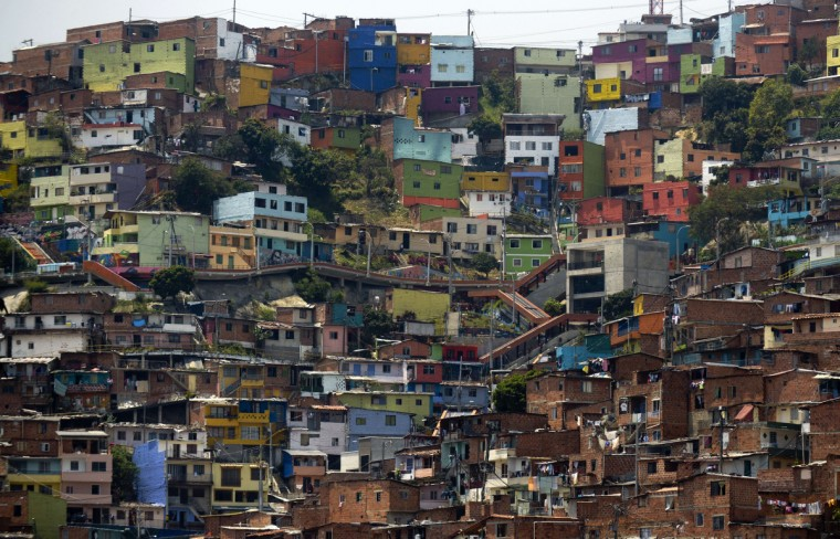 """The Comuna 13 shantytown, one of the poorest areas of Medellin, Antioquia department, Colombia, is seen ahead of the World Urban Forum 7, which will take place from April 5 to 11. Medellin was chosen by popular vote through the internet as """"Innovative City of the Year"""" in a contest organized by The Wall Street Journal and Citigroup in 2013. The distinction was basically made for its modern transportation system, public library, escalators built in a shantytown and schools that have allowed the integration of society. (Raul Arboleda/Getty Images)"""