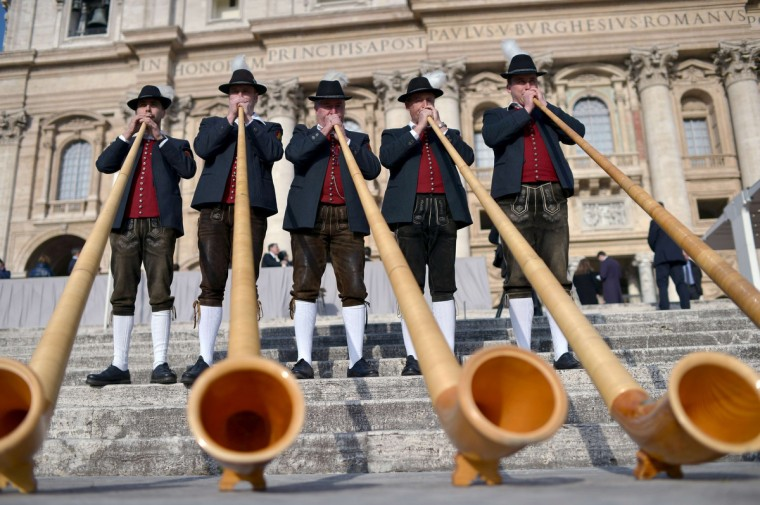 Bavarian musicians from Engetried play traditional horns in St. Peter's square prior to the pope's weekly general audience at the Vatican. (Gabriel Bouys/Getty Images)