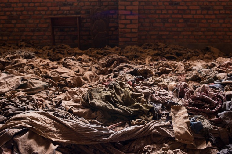 This photo taken on March 12, 2014, shows the clothes of victims killed during the Rwandan genocide laid out in the Nyamata Church in Nyamata, Rwanda. Nyamata and the surrounding area suffered some of the worst violence during the 1994 Genocide Against the Tutsi, with thousands of people killed in and around the church, which now stands as a memorial to the genocide. A survey showed that 26 percent of the Rwandan population suffers from post-traumatic stress disorder, yet the country lacks the adequate mental health facilities needed to address this issue. (Phil Moore/AFP/Getty Images)