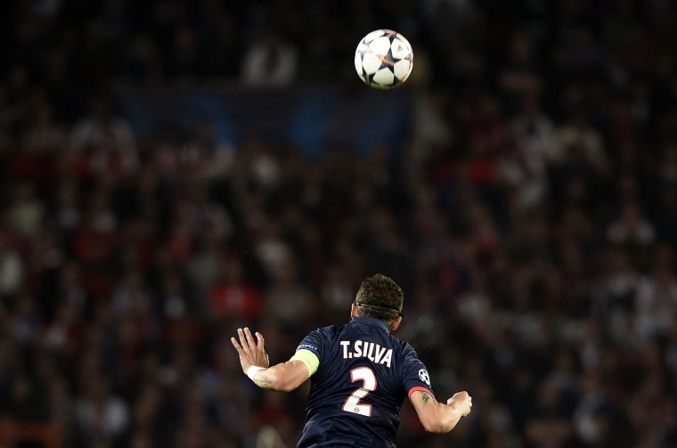 Paris' Brazilian defender Thiago Silva jumps for the ball during the UEFA Champions League quarter-final first leg football match Paris Saint-Germain vs Chelsea, on April 2, 2014 at the Parc-des-Princes stadium in Paris. (Franck Fife/AFP/Getty Images)