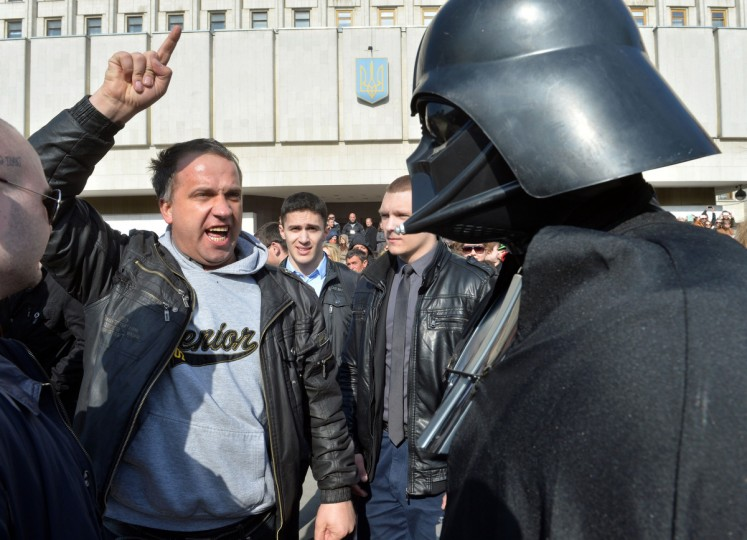 A man shouts at a man dressed as Darth Vader, who announced he was running for president as the official candidate of the Ukrainian Internet Party (UIP). (Sergei Supinsky/Getty Images)