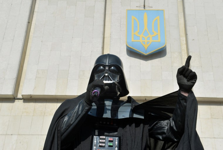 A man wearing the outfit of iconic movie villain Darth Vader, who announced he was running for president as the official candidate of the Ukrainian Internet Party (UIP), speaks as he takes part to a protest action in front of the Central Election Commission building in Kiev. (Sergei Supinsky/Getty Images)