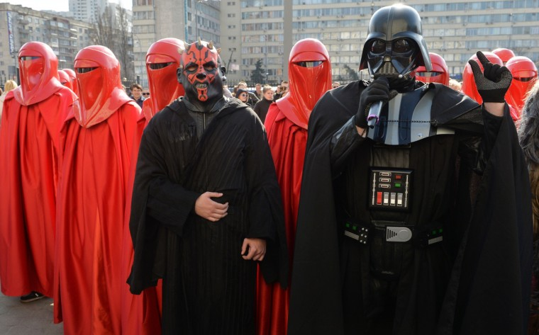 Protesters dressed as Darth Vader, Darth Maul and Emperor's Royal Guards take part to a protest action in front of the Central Election Commission building in Kiev. (Sergei Supinsky/Getty Images)