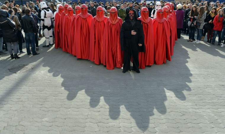 A man wearing the outfit of iconic movie villain Darth Maul (C), surrounded by men dressed as Emperor's Royal Guards, take part to a protest action in front of the Central Election Commission building in Kiev. (Sergei Supinsky/Getty Images)