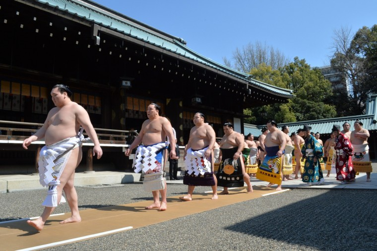 "Sumo wrestlers attend a traditional Shinto ceremony at Yasukuni shrine in Tokyo on April 4, 2014. Sumo wrestlers took part in a ""honozumo"", a ceremonial one-day exhibition for hundreds of spectators held within the shrine's precincts. (Kazuhiro Nogi/Getty images)"