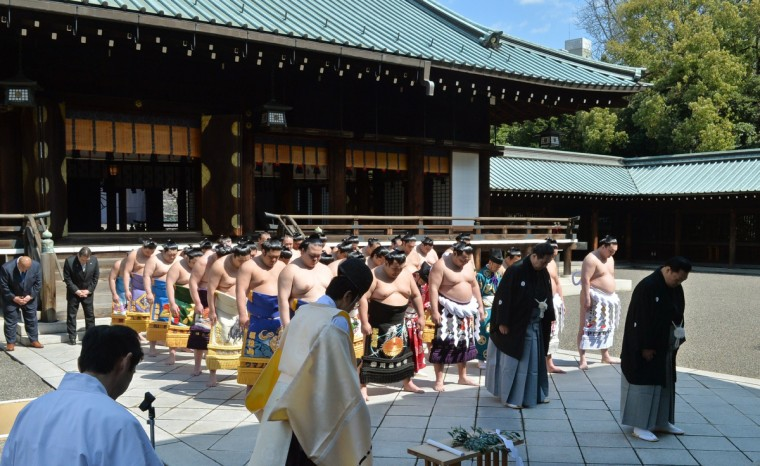 "The heads of the Japan Sumo Association and sumo wrestlers attend a traditional Shinto ceremony at Yasukuni shrine in Tokyo on April 4, 2014. Sumo wrestlers took part in a ""honozumo"", a ceremonial one-day exhibition for hundreds of spectators held within the shrine's precincts. (Kazuhiro Nogi/Getty images)"