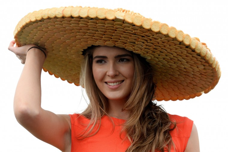 "A model wears a hat made from cheese buscuits on ""Ladies Day"" at the Grand National horse race meeting at Aintree in Liverpool, northwest England, on April 4, 2014. (Andrew Yates/Getty Images)"