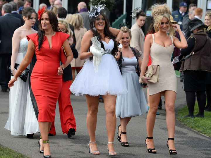 "Racegoers arrive for ""Ladies Day"" at the Grand National horse race meeting at Aintree in Liverpool, northwest England, on April 4, 2014. (Andrew Yates/Getty Images)"
