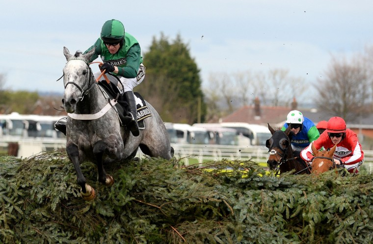 Ma Filleule ridden by Barry Geraghty clears the last fence on its way to winning the Topham Steeple Chase during Ladies Day during the Grand National horse race meeting at Aintree in Liverpool, northwest England on April 4, 2014. (Andrew Yates/Getty Images)