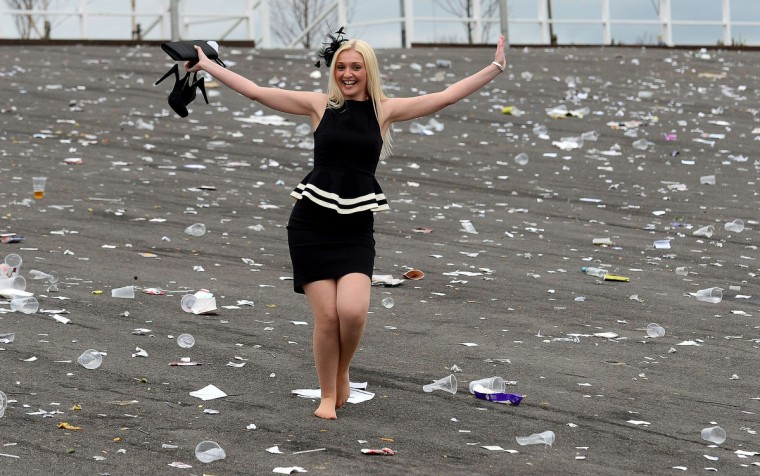 A racegoer leaves the course at the end of Ladies Day of the Grand National horse race meeting at Aintree in Liverpool, northwest England, on April 4, 2014. (Andrew Yates/Getty Images)