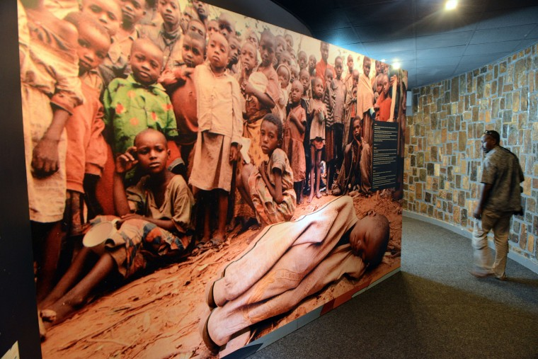 A visitor looks a large picture of children victims of the 1994 Rwandan genocide on April 4, 2014 at the Genocide memorial in Nyamata, inside the Catholic church where thousands were slaughtered during the 1994 genocide in Rwanda. Twenty years after the genocide of Rwanda's Tutsi minority, the massacres of Hutu civilians who fled across the border into the DR Congo remain a taboo subject in Kigali.(Simon Maina/AFP/Getty Images)