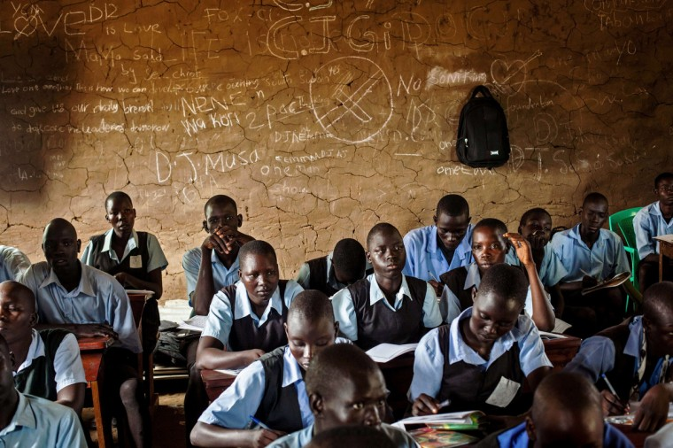 Students take notes during an English language class at the Juba Nabari Primary School, in Juba. Recent conflict in the country has made resources scarce, many civil servants, including teachers, have not received their pay for several months. (Andrei Pungovschi/Getty Images)