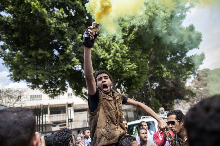 Egyptian students, supporters of the Muslim Brotherhood and ousted Islamist president Mohamed Morsi, demonstrate outside Cairo University. An Egyptian appeals court rejected a request that new judges be appointed for two trials involving ousted Islamist president Mohamed Morsi, judicial officials said. (Mahmoud Khaled/Getty Images)