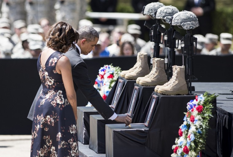 US President Barack Obama and First Lady Michelle Obama pay their respects during a memorial service at Fort Hood in Texas. US President Barack Obama attended the memorial service for the 3 killed and 16 wounded during last weeks shooting at the post by Army Specialist Ivan Lopez who later took his own life. (Brendan Smialowski/Getty Images)
