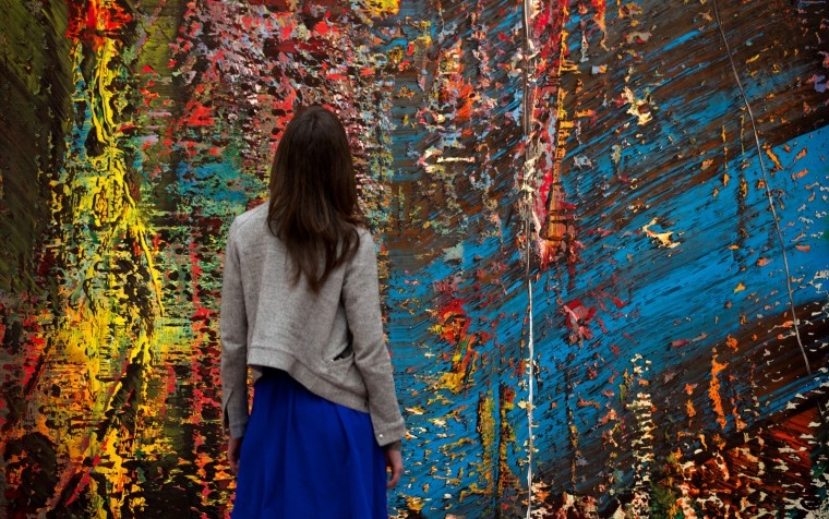 "A Sotheby's employees look at ""Blau"" 1988, by artist Gerhard Richter, during a photo call in central London on April 11, ahead of the forthcoming New York auctions of contemporary, impressionist and modern art. 