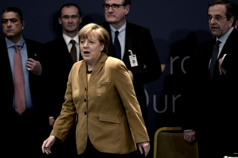 German Chancellor Angela Merkel   (C) followed by the Greek prime minister Antonis Samaras (R)  arrives for a meeting with young Greek  businessmen  in a hotel in  Athens on April 11.  Merkel visits Greece on Friday to applaud reform efforts, a day after the eurozone laggard made a triumphant return to bond markets. In her second visit to Athens in two years, Merkel is expected to discuss Germany's contribution to a 500-million-euro ($690-million) investment fund to help the Greek economy shake off a