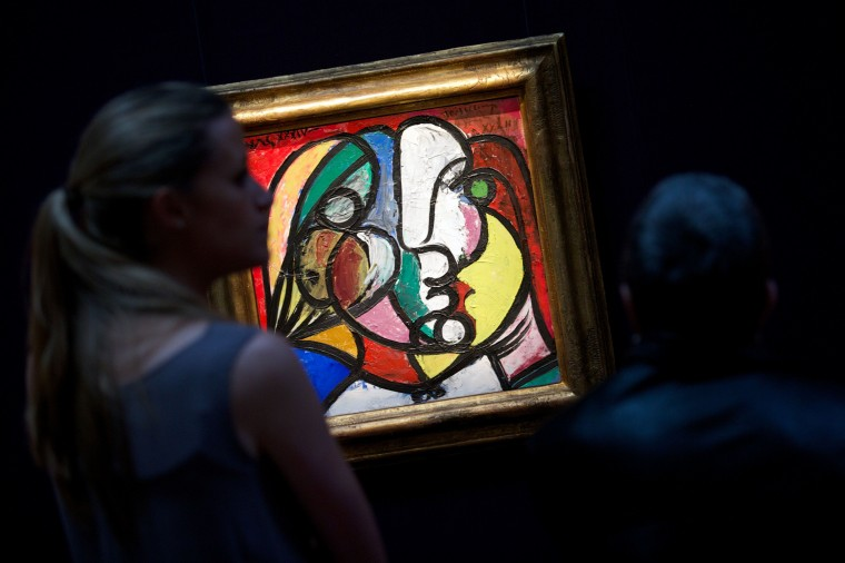 "Visitors look at ""Tete de Marie-Therese"" by Pablo Picasso during a photo call in central London on April 11, ahead of the forthcoming New York auctions of contemporary, impressionist and modern art.  