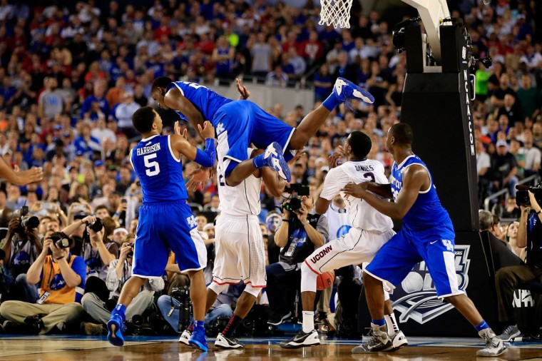 Alex Poythress #22 of the Kentucky Wildcats falls over DeAndre Daniels #2 of the Connecticut Huskies during the NCAA Men's Final Four Championship at AT&T Stadium on April 7, 2014 in Arlington, Texas. (Photo by Jamie Squire/Getty Images)