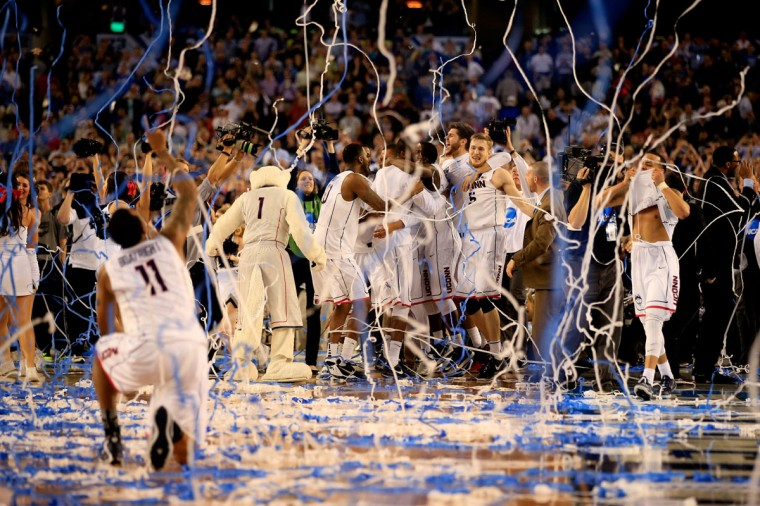 The Connecticut Huskies celebrate after defeating the Kentucky Wildcats 60-54 in the NCAA Men's Final Four Championship at AT&T Stadium on April 7, 2014 in Arlington, Texas. (Photo by Jamie Squire/Getty Images)