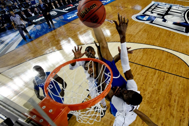 James Young #1 of the Kentucky Wildcats dunks over Amida Brimah #35 of the Connecticut Huskies during the NCAA Men's Final Four Championship at AT&T Stadium on April 7, 2014 in Arlington, Texas. (Photo by Chris Steppig-Pool/Getty Images)