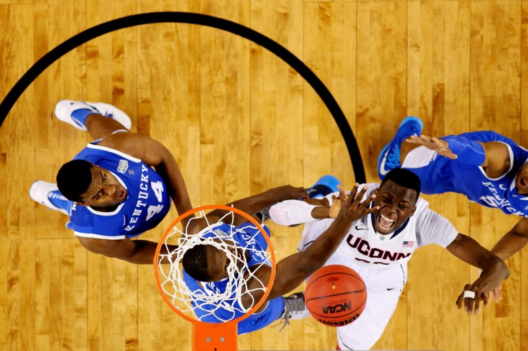 Amida Brimah #35 of the Connecticut Huskies battles with Julius Randle #30 of the Kentucky Wildcats for a rebound during the NCAA Men's Final Four Championship at AT&T Stadium on April 7, 2014 in Arlington, Texas. (Photo by Jamie Squire/Getty Images)