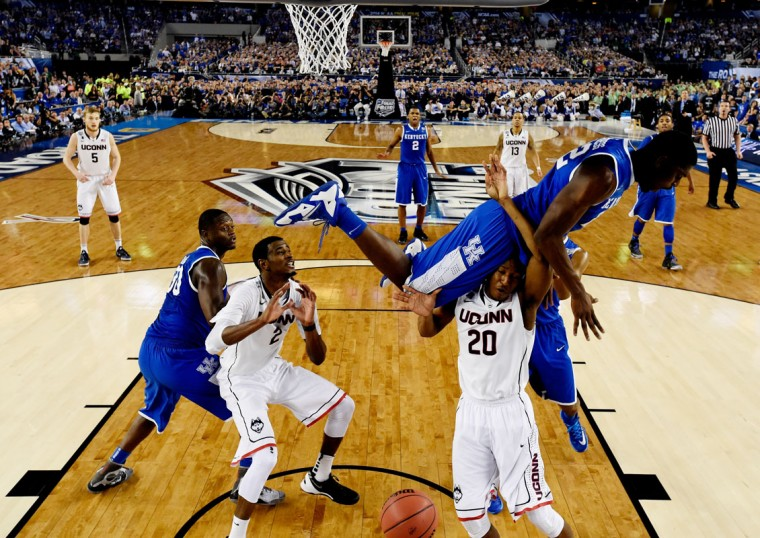 Alex Poythress #22 of the Kentucky Wildcats falls over Lasan Kromah #20 of the Connecticut Huskies during the NCAA Men's Final Four Championship at AT&T Stadium on April 7, 2014 in Arlington, Texas. (Photo by Chris Steppig-Pool/Getty Images)