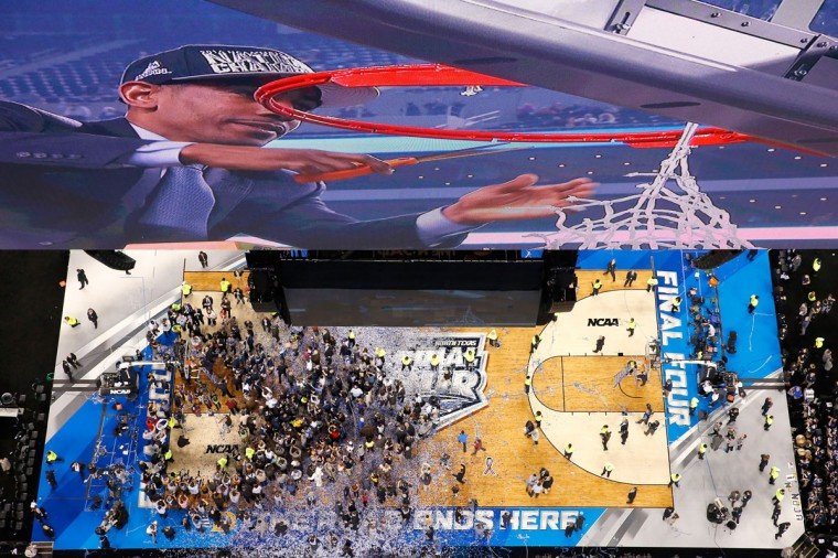 Head coach Kevin Ollie of the Connecticut Huskies cuts down the net after defeating the Kentucky Wildcats 60-54 in the NCAA Men's Final Four Championship at AT&T Stadium on April 7, 2014 in Arlington, Texas. (Photo by Tom Pennington/Getty Images)