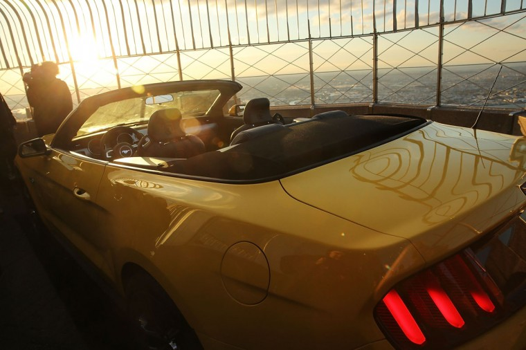 The new 2015 Mustang convertible is viewed on top of the observation deck at the Empire State Building in honor of 50 years of the Ford Mustang on April 16, 2014 in New York City. In 1965 a prototype Ford Mustang convertible made its way to the top of the observation deck. This time the iconic American car had to be brought up in parts and assembled on location. The Mustang will be on display for two days in celebration of the kick-off of the 2014 New York International Auto Show. (Photo by Spencer Platt/Getty Images)