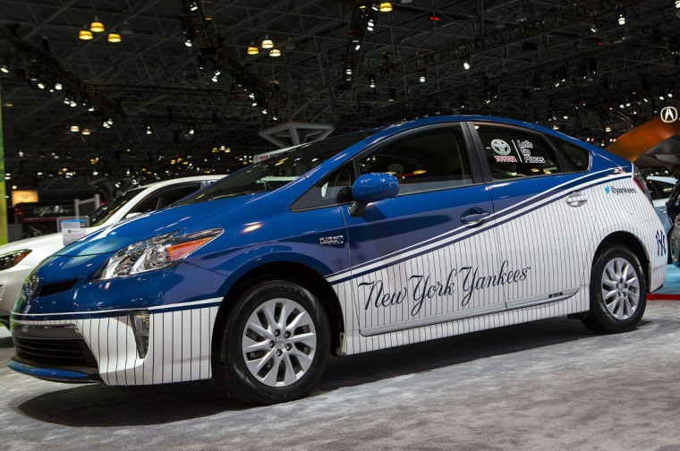 A Toyota Prius painted with New York Yankees colors sits on display during a media preview of the 2014 New York International Auto Show at the Jacob Javits Convention Center on April 17, 2014 in New York City. The show opens with a sneak preview to the public April 18 and runs through April 27. (Photo by Eric Thayer/Getty Images)