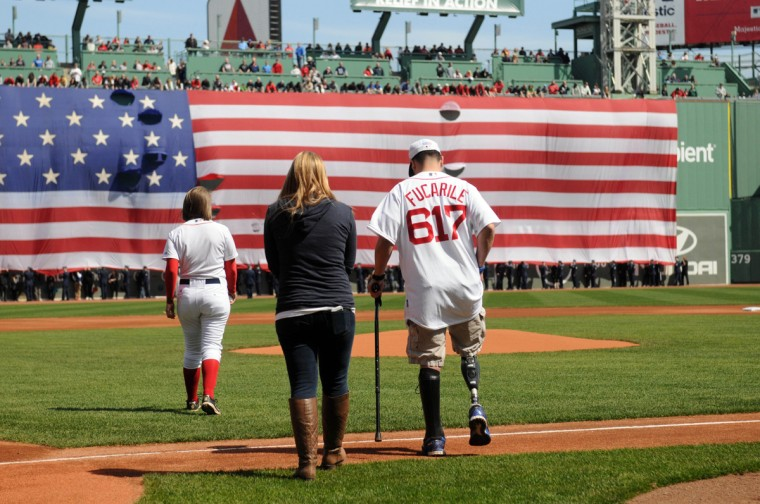 Marc Fucarile, injured in last years Boston Marathon bombings, prepares to throw out the first pitch prior to the Boston Red Sox/ Baltimore Orioles game at Fenway Park April 21, 2014 in Boston, Massachusetts. (Darren McCollester/Getty Images)