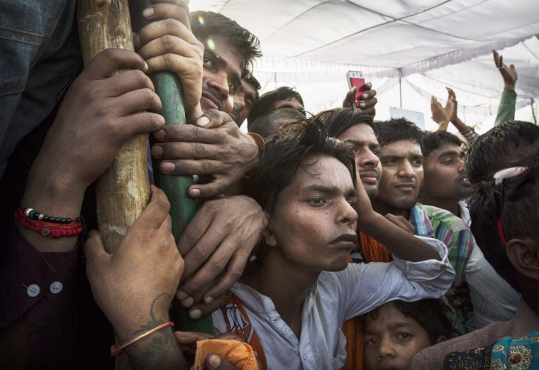 Villagers and supporters listen to a speech by BJP leader Narendra Modi at a rally on April 27, 2014 in Sidhuali near Lucknow, India. India is in the midst of a nine phase election that began on April 7 and ends May 12. (Kevin Frayer/Getty Images)