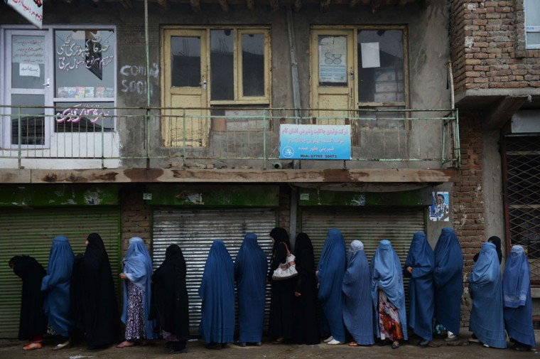 Afghan women preparing to vote line up outside a local polling station in Kabul on April 5, 2014. Afghan voters went to the polls to choose a successor to President Hamid Karzai, braving Taliban threats in a landmark election held as US-led forces wind down their long intervention in the country. Afghanistan's third presidential election brings an end to 13 years of rule by Karzai, who has held power since the Taliban were ousted in a US-led invasion in 2001, and will be the first democratic handover of power in the country's turbulent history. (Shah Marai/AFP/Getty Images)