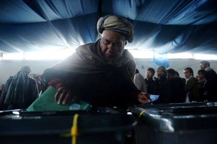 An Afghan man casts his vote at a local polling station in Kabul on April 5, 2014. Afghan voters went to the polls to choose a successor to President Hamid Karzai, braving Taliban threats in a landmark election held as US-led forces wind down their long intervention in the country. (Shah Marai/AFP/Getty Images)