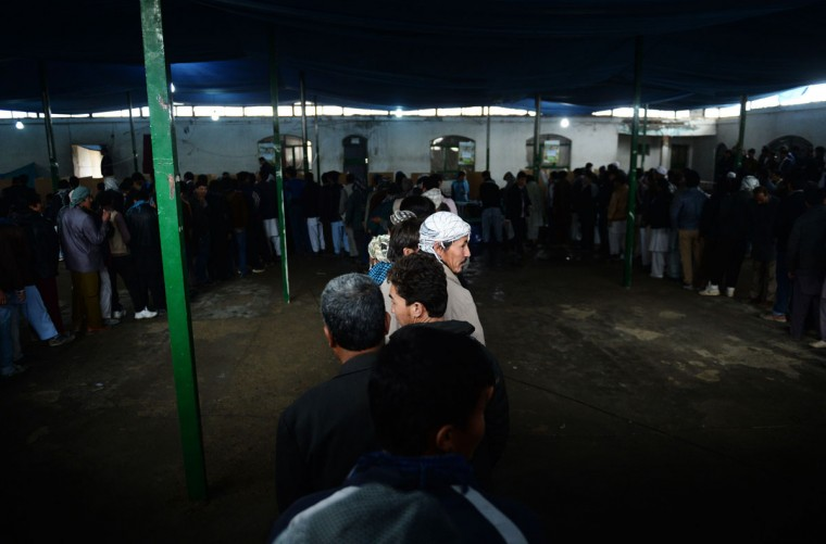 Afghan residents line up to vote inside a polling station in Kabul on April 5, 2014. Afghan voters went to the polls to choose a successor to President Hamid Karzai, braving Taliban threats in a landmark election held as US-led forces wind down their long intervention in the country. Afghanistan's third presidential election brings an end to 13 years of rule by Karzai, who has held power since the Taliban were ousted in a US-led invasion in 2001, and will be the first democratic handover of power in the country's turbulent history. (Shah Marai/AFP/Getty Images)