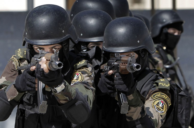 Female members of the Palestinian presidential guard take part in a training session in the West Bank city of Jericho on April 6, 2014. (Ahmad Gharabli/AFP/Getty Images)
